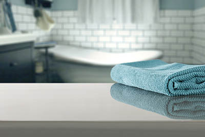 Blue blurred background of bathroom interior with towel.